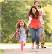 117-149057179x186_Outdoor_FamilyWalkOlderGirlLeading